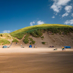 summer seaside scene (Jon Downs) Tags: uk blue red sky people orange cloud white holiday color colour green art colors yellow clouds digital downs lumix photography bay photo seaside sand jon flickr artist colours photographer image dunes united dune picture kingdom pic scene devon photograph woolacombe gf5 jondowns