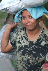 portrait of a woman (ubo_pakes) Tags: poverty street portrait woman smile bag bottle nikon asia pretty philippines poor cardboard cebu pinay filipina lovely recycling load visayas collector carrying d60 liloan ubo beeautiful pakes scaveging mygearandme liloanstreet