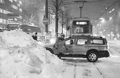 But Where Is the Tram Driver? (womanish) Tags: street winter woman snow storm car helsinki walk trolley jam tam mannerheimintie
