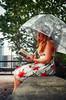 The Reader (flashfix) Tags: september082016 2016 2016inphotos nikond7000 nikon ottawa ontario canada 40mm umbrella woman redhair portrait selfportrait book reading thetwelvebywilliamgladstone tree fence downtown buildings hideaway flashfix flashfixphotography