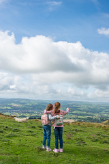 Sisters Enjoying the view (joocer.) Tags: wales children sisters hill mountain looking countryside moelfamau outdoors trek walk daytrip northwales sheep girls 6yo 7yo pointing 35mm nikon d800 view vista