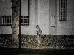 The shining (ParadoX_Design) Tags: girl blue dress blackandwhite low color street phone building people woman backpack