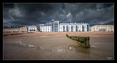 Storm Brewing over Sunny Worthing (Nathan Dodsworth Photography) Tags: weather storm clouds rain reflections building architecture promenade beach coastlight seadefences mood sand shingle atmospheric worthing westsussex uk water outdoors