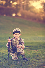 Little Soldier (Rebecca812) Tags: boy sunset portrait sunlight cute halloween grass childhood soldier army outdoors costume gun child play blueeyes rifle dressup american camouflage irony imagination tradition bandana toygun pretend fiveyears blondhair canon5dmarkii rebecca812