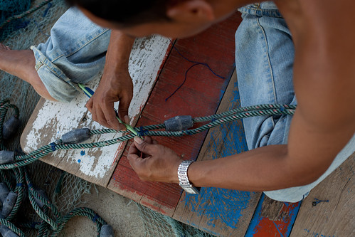 Fixing fishing tackle in Aceh, Indonesia. Photo by Mike Lusmore/Duckrabbit, 2012.