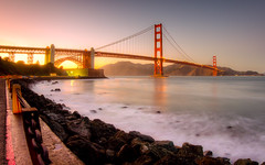 Golden Sunset (tobyharriman) Tags: pictures ocean sf sanfrancisco bridge flowers sunset seascape beautiful architecture canon photography bay colorful scenic large fisheye bayarea prints sanfran hdr fortbaker photomatix goldengatebridgebridge indurotripod tobyharriman fusionblend