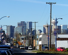 van12k13 East Cordova view of Downtown Vancouver (CanadaGood) Tags: morning blue red orange canada color colour building vancouver downtown bc traffic britishcolumbia parking powerlines streetphoto strathcona 2012 cordovastreet canadagood thisdecade