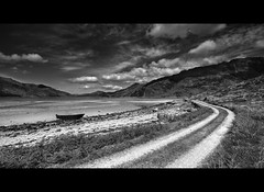 Loch Hourn - Knoydart (Michael~Ashley) Tags: white black mountains west beach clouds landscape mono scotland boat highlands track scottish loch tranquil munros knoydart hourn