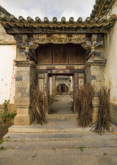 Old Chinese traditional gate At Tuan Shan Village, Yunnan Province, China (Eric Lafforgue) Tags: china door old house color colour history vertical architecture outdoors gate asia entrance nobody nopeople carving yunnan traditionalculture eastasia chineseculture colorimage colorpicture yunnanprovince tuanshan a0006335