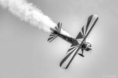 Susan Dacy in Big Red (dpsager) Tags: airshow2016 bigred chicago chicagoairandwatershow dpsagerphotography lakemichigan lakefront superstearmanmodel70 susandacy aircraft airplane blackwhite blackwhitephotos