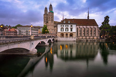Grossmunster Church and Limmat River in the Morning, Zurich, Switzerland (ansharphoto) Tags: architecture basilica belfry bell blue bridge building capital cathedral center church city cityscape culture cupola dawn embankment europe european grossmuenster grossmunster helvetica historic history iconic illuminated landmark lights limmat medieval monastery monument morning night old religion river sky skyline street swiss switzerland tourism tower town travel twilight urban water zurich