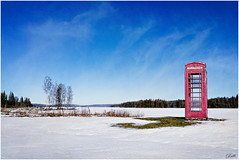 Old English Telephone Box in Filipstad (mad_ruth) Tags: sweden filipstad vrmland sky snow blue red telephonebox ice frozen lake