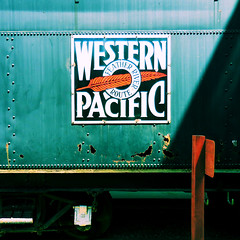 Rust is a slow fire (Dom Guillochon) Tags: vintage wagon train sign westernpacific steel oxygen reaction metal holes decay rust sunlight time humans life traveltown griffithpark losangeles