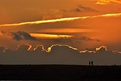 Walking on the jetty (Lostinplace) Tags: oregoncoast oregon orange newport newportoregon jetty backlit clouds people couple sillouette sunset shadows