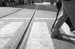 Valparaso Abbey Road (Robert.Kincaid) Tags: people bw blancoynegro film 35mm puerto calle floor legs wideangle bn personas pointandshoot pelicula ilfordhp5plus400 valparaso suelo piernas piso pavimento calzada pasocebra pasopeatonal konicalexio70