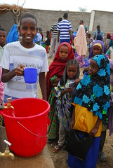 Kadir Hassen showing the proper way to use taps to his youngest (UNICEF Ethiopia) Tags: africa unicef school girls youth children education health wash ethiopia childprotection ruralareas harmukayle nutritionun
