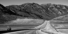 Open road (CNorthExplores) Tags: road travel autumn vacation bw usa white black mountains fall canon utah highway driving open united north powershot states divided 91 mantua 89 g11