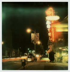 Hollywood Downtowner Inn (tobysx70) Tags: california ca street light toby color sign night project polaroid sx70 star la los inn neon boulevard crossing nocturnal angeles tail banner n motel pedestrian illuminated trail tip hollywood headlight lit sonar hancock protection blvd impossible the downtowner 5601 px70 theimpossibleproject tobyhancock impossaroid colorprotection