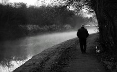 Man, Dog and Mist (PaulEBennett) Tags: dog white mist black misty mono canal walker wigan poolstock