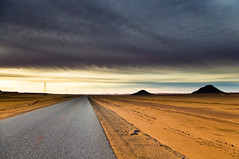 Desert road (albatros11) Tags: road travel cloud sahara algeria desert cloudy route algrie bitume inamenas