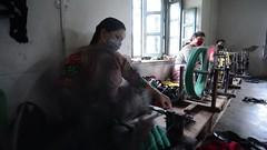 Round & Round We Go (www.WeAreHum.org) Tags: textile nepal thread bobbins gandhi tulsi ashram school for women kathmandu sowing weaving winds threads mechanical loom wood shuttles feet arts