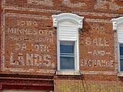 Eck & Getsch Land Co., Nashua, IA (Robby Virus) Tags: nashua iowa ghost sign faded forgotten wall brick ad advertisement eck getsch land company co minnesota north south dakota lands sale exchange