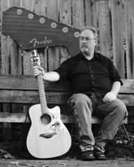 IMG_3729 (giltay) Tags: topw topwppl torontophotowalks torontophotowalksportraitsandpotluck sean guitar acousticguitar bench fender takumarsmc55mmf18