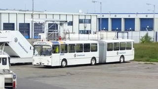 old Mercedes bus in use as platform bus at Bucharest Airport, Romania