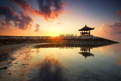 Resting In Sanur Beach (Adly Wook) Tags: sky red rock reflection explore art asian awesome atmosphere landscape canon wallpaper bali nature water natural longexposure light indonesia island interesting photography seascape people kid cycle sunbrust outdoor ocean oversea composition motion tone travel trip texture