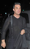 Robbie Williams leaves HMV in Oxford Street and heads for the Grosvenor House Hotel. London