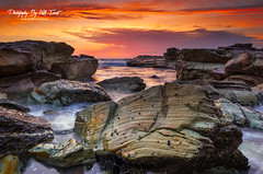 Chalky's (Kiall Frost) Tags: ocean red orange sun seascape color colour beach water swansea clouds sunrise newcastle print landscape photography photo intense rocks photographer image australia canvas nsw chalkys kiallfrost
