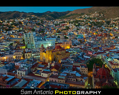 The Beauty of Guanajuato, Mexico at Twilight (Sam Antonio Photography) Tags: city travel roof light sky house church latinamerica vertical horizontal skyline architecture night mexico outdoors photography town twilight day cityscape dusk hill colonial aerialview nopeople illuminated latin northamerica civilization guanajuato block bluehour vibrantcolor travelphotography traveldestinations colorimage famousplace buildingexterior highangleview builtstructure residentialstructure samantonio samantoniocom mostbeautifulcityinmexico