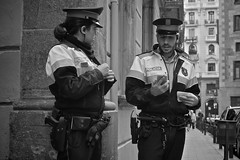 if you had to be shot by Police..... (martin.mutch) Tags: barcelona street city girls people urban white black men kids real photography mono spain natural candid strangers tourist catalan ramblas attractions tonality