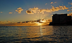 Sunset from Kuhio Beach Park (jcc55883) Tags: ocean sunset sky clouds hawaii nikon waikiki oahu horizon pacificocean canoes yabbadabbadoo d40 kalakauaavenue sheratonwaikiki kuhiobeachpark nikond40