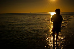 Fisherman (Bradley Nash Burgess) Tags: light sunset shadow sun fish beach silhouette al fishing fisherman nikon alabama pole gulfshores gulfshoresal d80 nikond80