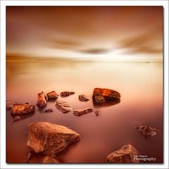 Silent stones (Ivn Maigua) Tags: light red sky seascape colors golden nikon rocks thenetherlands sigma ivn hdr marken nikond200 artistictouch ivnmaigua silentstones
