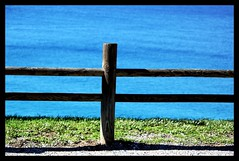 """""""Genuine poetry can communicate before it is understood"""".  T. S. Eliot ( fotodisignorina  Felicia Violi PHOTOGRAPHY) Tags: blue sea green digital canon fence photography eos reflex poetry dof dep genuine tseliot"""