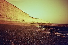 RedScaled Undercliff (Chornukopia) Tags: light sea sky film beach water 35mm lomo lca lomography brighton waves lofi lomolca analogue vignetting milf manualfocus brightonandhove brightonmarina redscale lomofi lomographyfilm manilovefilm lomographyredscalefilm100iso
