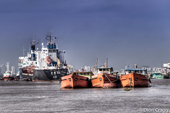 Red Barges (Dion Cragg) Tags: river boats asia southeastasia harbour ships vietnam saigon hdr hmc hochiminh wwb barges