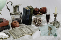 Moral Discourses (lwarren18) Tags: world blue red stilllife white flower green clock glass vintage table death mirror book globe candle wine time vanity seed pomegranate pearl vane pitcher utensil grape jewel decanter worldly wealth vanitas tablescape
