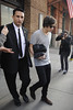 Harry Styles of One Direction, carrying a toiletry bag, is seen leaving the hotel that he and Taylor Swift arrived at earlier today New York City