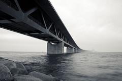 Oresund Bridge, Malmo, Sweden (Yoshing_) Tags: ocean travel bridge sea blackandwhite water metal clouds landscape photography rocks europe sweden ripple malmo oresund lensblr photographersontumblr