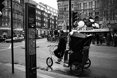 Singing In The Rain (Nick Lambert!) Tags: uk blackandwhite bw london fuji tuktuk westend fujix100