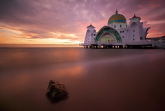 Malacca Straits Mosque (TheFella) Tags: ocean travel sunset sea sky sun seascape slr water rock architecture clouds photoshop canon landscape person eos asia southeastasia purple cloudy dusk muslim islam fineart smooth stormy landmark mosque photograph malaysia blended 5d dslr melaka islamic lavendar mkii blending markii greenwichpark travelphotography mallaca thefella 10nd 5dmarkii conormacneill thefellaphotography mallacastraitsmosque lpflow