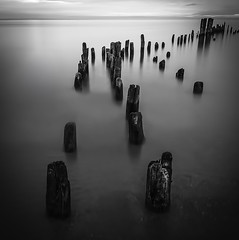 Black And White Remnants (rseidel3) Tags: longexposure morning blackandwhite bw lake water clouds photoshop sunrise pier early nikon lakemichigan greatlakes adobe lightroom d7000