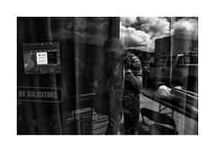 Lotus Inn, NO SOLICITORS (Richard C. Johnson: AKA fishwrapcomix) Tags: leicar8 elmarit28mm ilfordhp5 film scanfromnegative paxamericanus endofempire analogue analog filmisnotdead duluth minnesota ishootfilm civisromanussum thegreatrecession economicdownturn sunsetsinthewest sunrisesintheeast blackandwhite monochrome window refelctions clouds garynewduluth midwest text truck