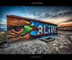 Alive and kicking (Nikos O'Nick) Tags: nikos kotanidis onick nicholas nick nikon d810 nikkor 1424mm f28 manfrotto 055xprob 498rc2 tripod hdr lemnos island greece hellas hotel abandoned kaveirio graffiti blue hour sunset building              clouds sky alive kicking wow limnos