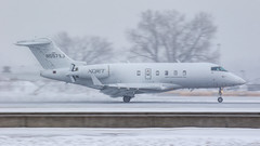 Snow Challenger (Skeeter Photo) Tags: minneapolisstpaulinternationalairport msp kmsp chrislundberg snow weather squall ils landing n557xj xojet bombardier bd1001a10 challenger 300 cl30
