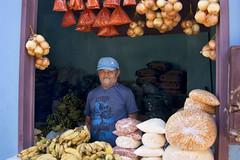 the blue fruit and veg shop (Jamie B Ernstein) Tags: nikon brazil feijo acre amazon market fruitmarket colour fruit man portrait