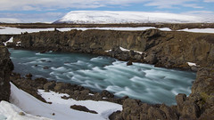 the flow that resists winter (lunaryuna) Tags: iceland centralnorthiceland highlands myvatnregion godafoss riverskjlfandafljt rivercanyon flow riverbed rapids le longexposure rockface landscape beauty panoramicviews winter season seasonalchange ice snow lunaryuna